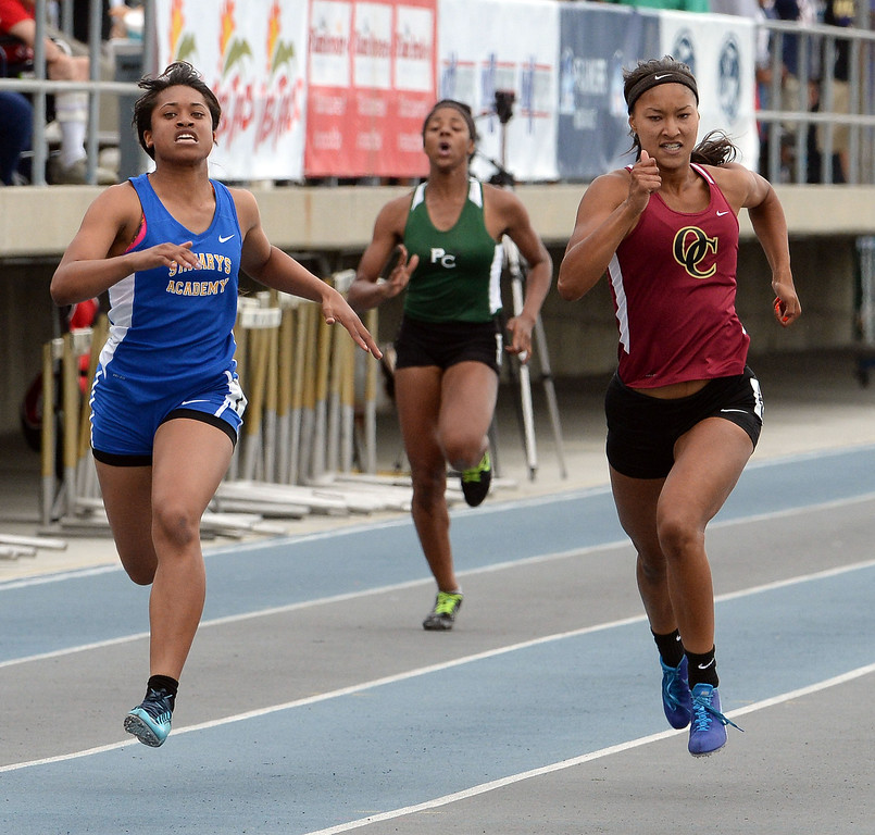 . Oaks Christian\'s Schuyler Moore, center, wins the division 4 200 meters race past St. Mary\'s Academy Sierra Peterson during the CIF Southern Section track and final Championships at Cerritos College in Norwalk, Calif., Saturday, May 24, 2014. 