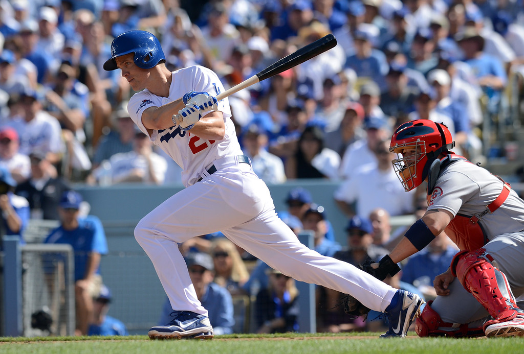 . Zack greinke singles in a run against the Cardinals in game 5 of the NLCS at Dodger Stadium Wednesday, October 16, 2013.  The Dodgers won the game 6-4.(David Crane/Los Angeles Daily News)