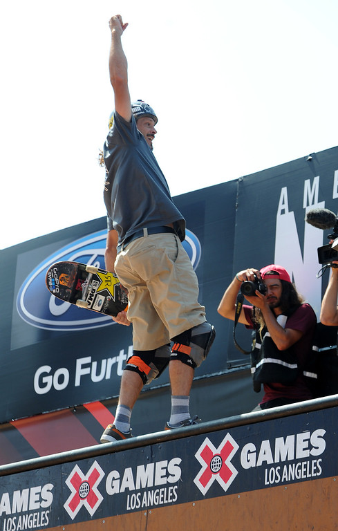 . Bucky Lasek celebrates a winning run on his way to first place during the Skateboard Vert Finals at L.A. Live in Los Angeles, CA. 8/3/2013(John McCoy/LA Daily News)