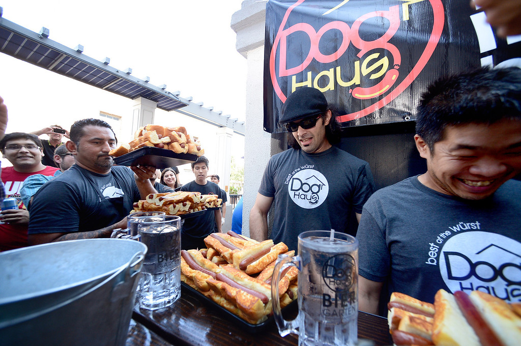 . Dog Haus Biergarten in Old Pasadena holds their First Annual Hot Dog Eating Competition Saturday, July 6, 2013 in Old Pasadena. Jimmy Lin won after eating 11 dogs, 3 during a tiebreaker.  (SGVN/Staff Photo by Sarah Reingewirtz)