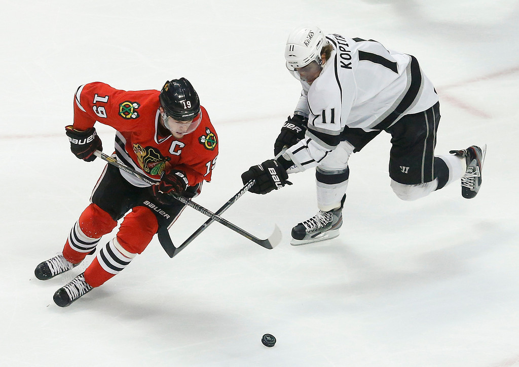 . Chicago Blackhawks center Jonathan Toews (19) battles for the puck against Los Angeles Kings center Anze Kopitar (11) during the first period in Game 2 of an NHL hockey Stanley Cup Western Conference finals Sunday, June 2, 2013 in Chicago. (AP Photo/Charles Rex Arbogast)