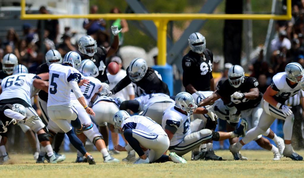 . Cowboy kicker Dan Bailey kicks a field goal at the Cowboys-Raiders practice in Oxnard, Wednesday, August 13, 2014. (Photo by Michael Owen Baker/Los Angeles Daily News)