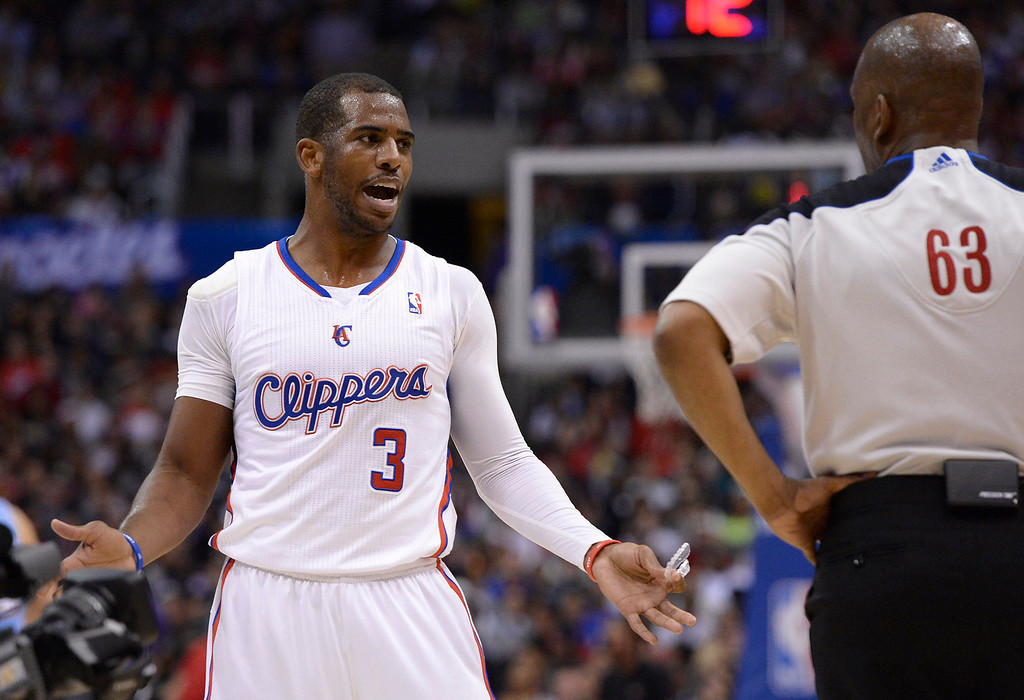 . Clippers#3 Chris Paul agues a foul in the first half. The Los Angeles Clippers took on the Denver Nuggets in a regular season NBA game. Los Angeles, CA. 4/15/2014(Photo by John McCoy / Los Angeles Daily News)