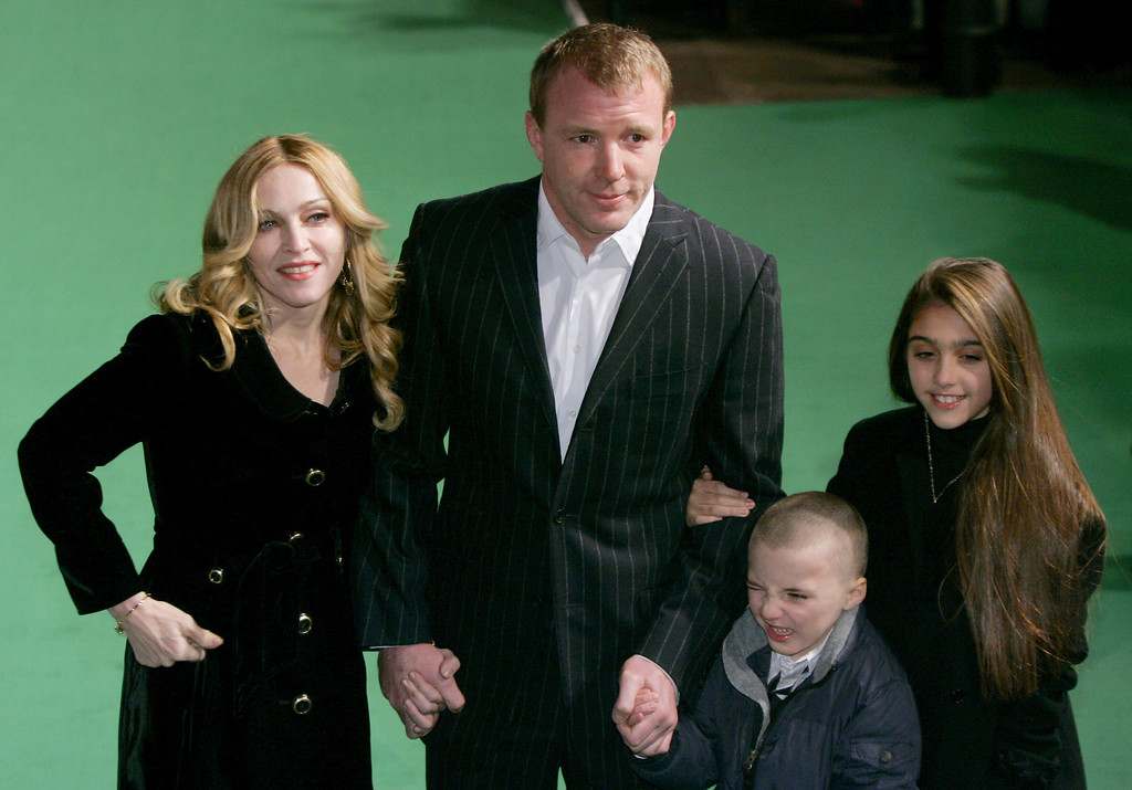 . Cast member U.S. singer Madonna, her husband British film director Guy Ritchie and children Rocco, third left, and Lourdes, right, pose for photographers as they arrive at the United Kingdom premiere of the film \'Arthur and the Invisibles\' at a West End cinema in Leicester Square, London, Thursday Jan. 25, 2007.  (AP Photo/Matt Dunham)