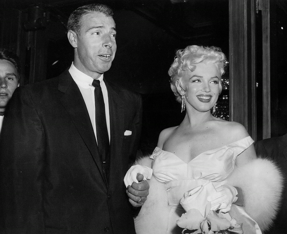 . In this June 2, 1955 file photo, actress Marilyn Monroe, right, in a glamorous evening gown, with Joe DiMaggio, arrives at the theater. (AP Photo, File)