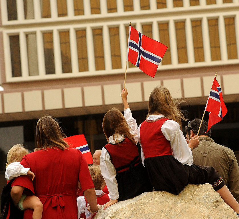 . Children wave Norwegian flags during the Sons of Norway\'s Celebration of Norway\'s Constitution Day in downtown San Bernardino May 17, 2013.  GABRIEL LUIS ACOSTA/STAFF PHOTOGRAPHER.