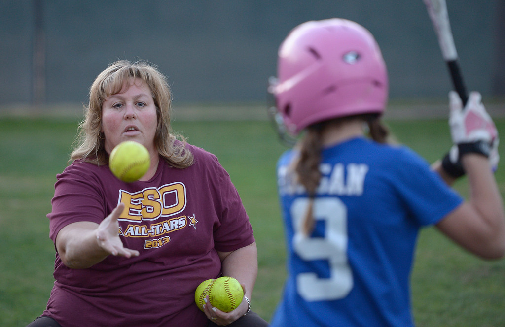 . Softball coach Delanee Durham tosses a ball during batting practice. A dispute has erupted between the nonprofit Encino-Sherman Oaks Softball � a four-year-old, award-winning fast-pitch league serving girls--and Mid-Valley Boys Baseball, which operates at the same complex at 17301  Oxnard St. Encino CA. February 5, 2014 (Photo by John McCoy / Los Angeles Daily News)