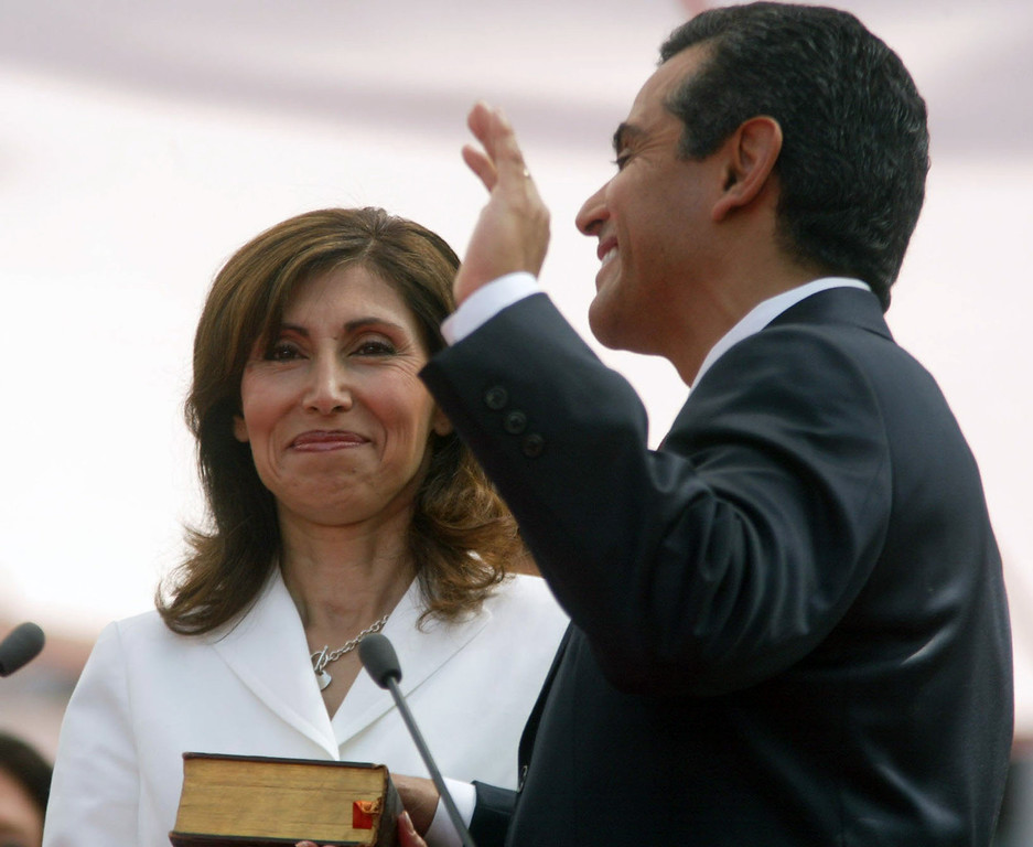 . Mayor Antonio Villaraigosa takes the oath of office during his inauguration at Los Angeles City Hall, July 1, 2005, as is his wife Corina, looks on. Mayor Antonio Villaraigosa announced Friday June 8, 2007, that he and first lady Corina Villaraigosa are separating after more than twenty years of marriage. (AP Photo/Gary Friedman, Pool, File)