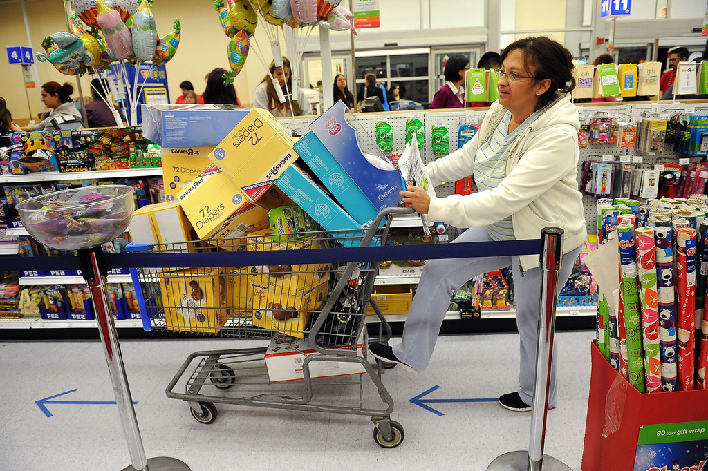 . Mary Ann Oadell waits to pay at the Porter Ranch Toys�R�Us  November 26, 2013.  Many retailers opened their doors with deals starting on Thanksgiving rather than on the traditional Black Friday.(Andy Holzman/Los Angeles Daily News)