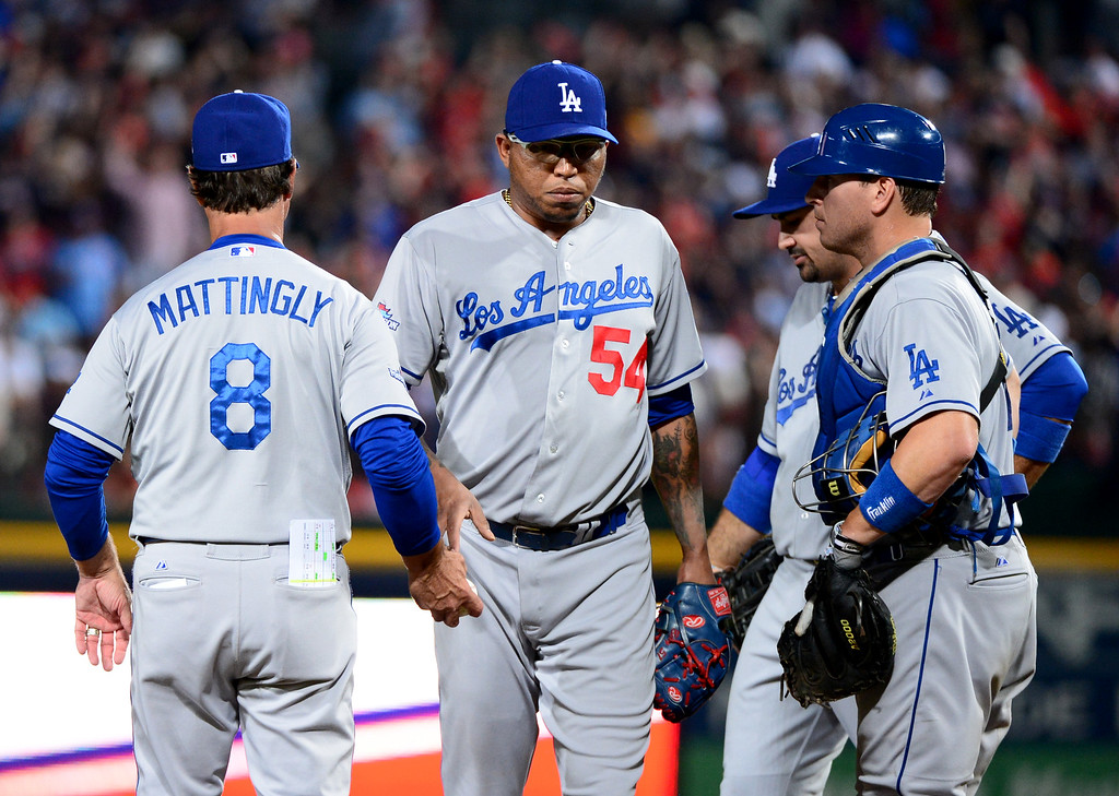 . Los Angeles Dodgers\' manager Don Mattingly changes pitchers in the eighth of game 2 of the playoffs Thursday, October 4, 2013 at Turner Field in Atlanta, Georgia. Braves defeated Dodgers 4-3. (Photo by Sarah Reingewirtz/Pasadena Star- News)