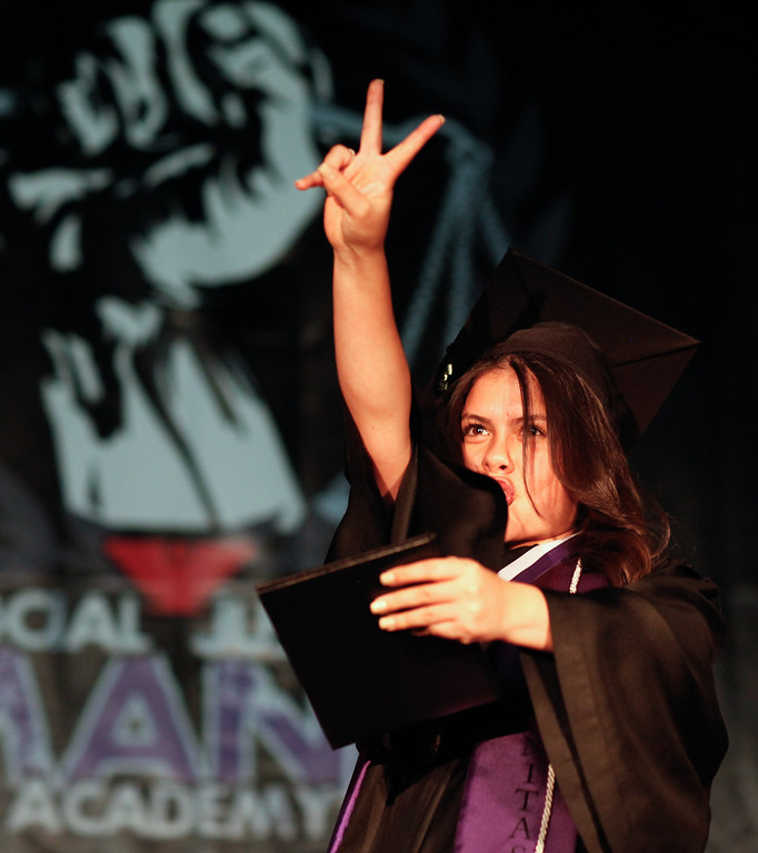 . Janett Torres has fun on stage during graduation at the Cesar Chavez Learning Academies Social Justice Humanitas Academy in San Fernando, Wednesday, June 5, 2013. (Michael Owen Baker/Staff Photographer)