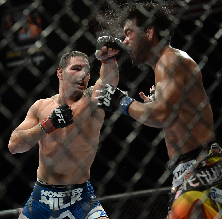 . UFC Middleweight champion Chris Weidman hits  challenger Lyoto Machida during UFC 175 at the Mandalay Bay Events Center July 5, 2014. Weidman defeated Machida to via judges decision in 5 rounds.  (Photo by Hans Gutknecht/Los Angeles Daily News)