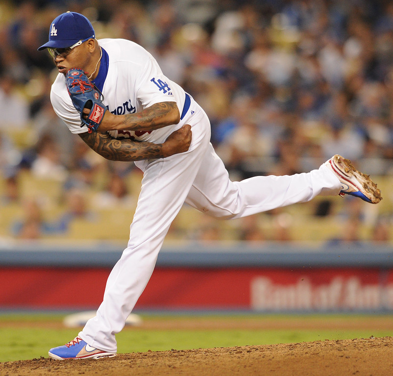 . Ronald Belisario gets work in the 7th inning. The Dodgers defeated the Arizona Diamondbacks 5-3 after Scott Van Slyke hit a 2 run walk off homer in the 11 inning at Dodger Stadium in Los Angeles, CA. 9/10/2013. photo by (John McCoy/Los Angeles Daily News)