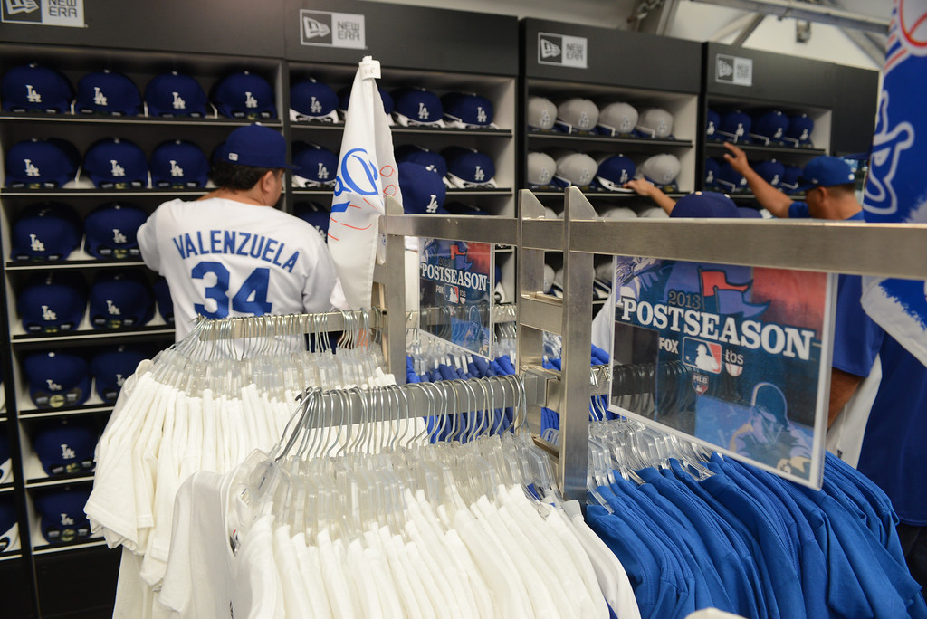 . Fans shop for Dodger merchandise at Dodger Stadium Sunday, October 6, 2013. (Photo by David Crane/Los Angeles Daily News)