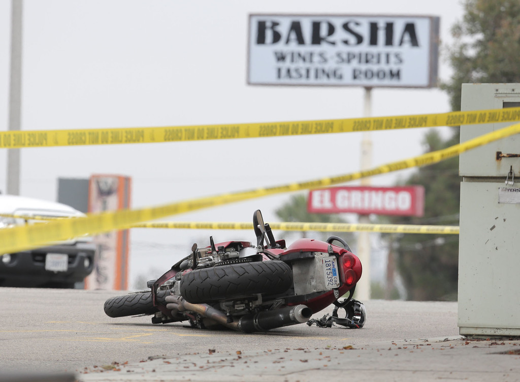 . Police officials investigate the scene of a double-fatality accident on Sepulveda Boulevard at Eighth Street in Manhattan Beach Tuesday morning. Chuck Bennett/Daily Breeze