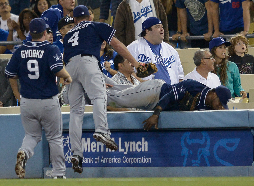 . Padres right fielder Rymer Liriano goes into the seats looking for a foul ball in the 9th inning. The Dodgers lost to the San Diego Padres 4-1 at Dodger Stadium. Los Angeles, CA. 8/20/2014(Photo by John McCoy Daily News)