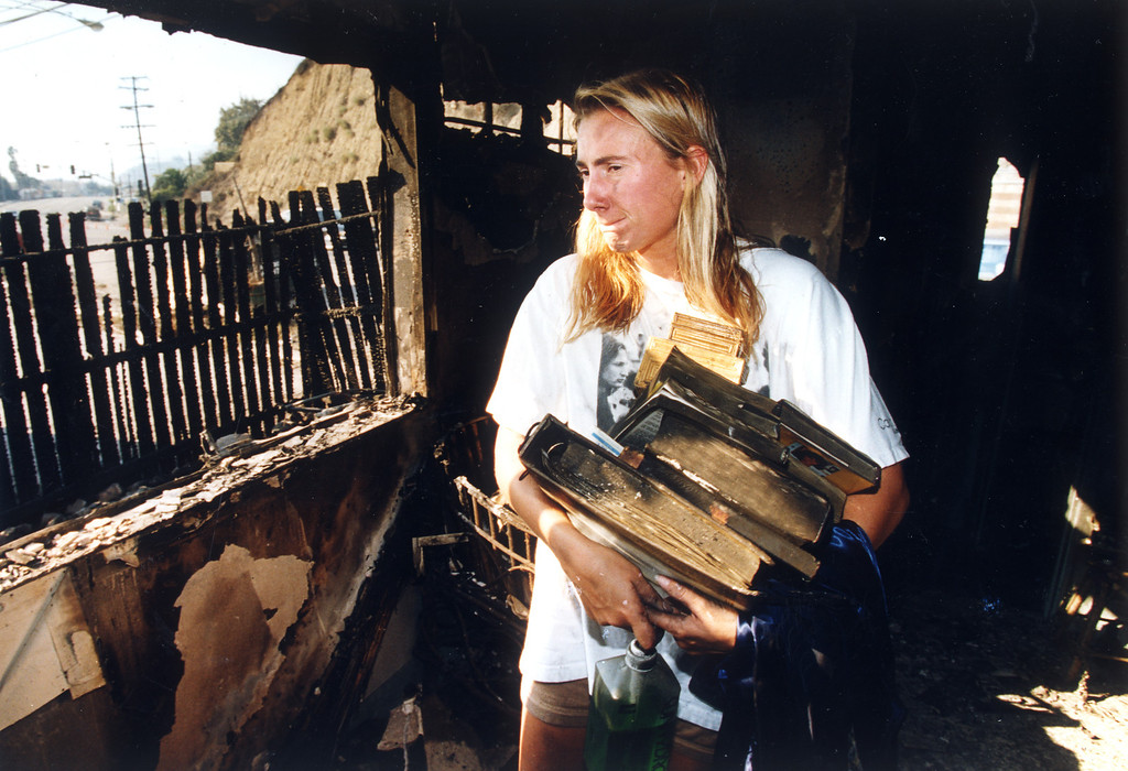 . Timberly Utz, a student at Pepperdine University, leaves her rented home, which was gutted.  (11/3/93)   Los Angeles Daily News file photo