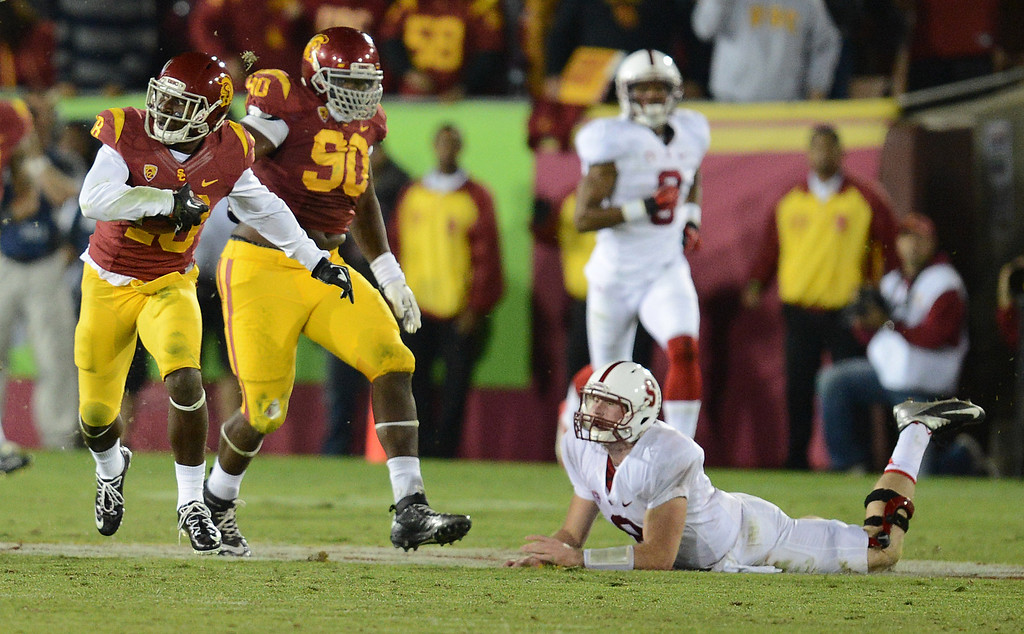 . USC�s Dion Bailey #18 heads up field after intercepting a Stanford\'s Kevin Hogan #8 pass in the second half during their game at the Los Angeles Memorial Coliseum Saturday, November 16, 2013. USC beat Stanford 20-17. (Photos by Hans Gutknecht/Los Angeles Daily News)