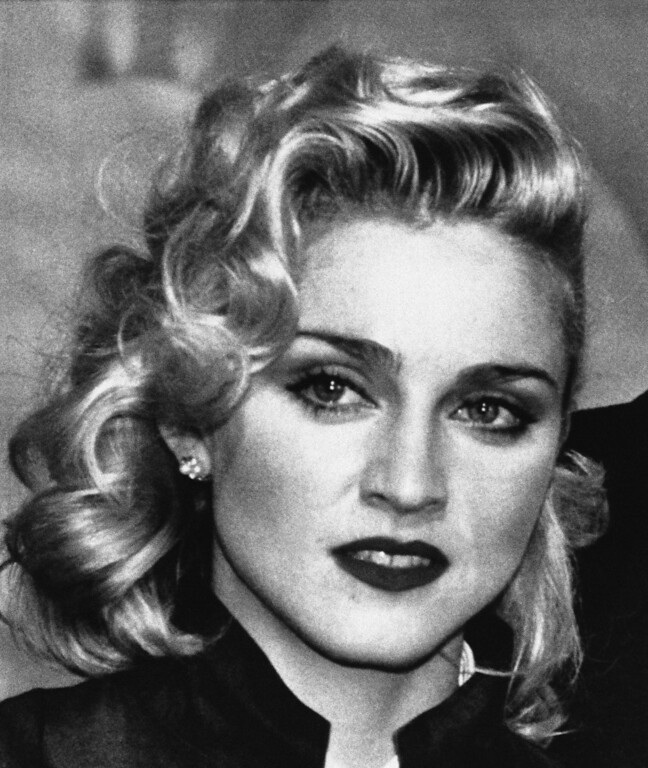 ". Rock star Madonna faces the press at London hotel in Thursday, March 7, 1986 in London, England during a news conference to promote the movie. ""Shanghai Surprise\"", in which she is starring. The film is being produced by Handmade Films, founded by former Beatle George Harrison. (AP Photo/Dave Caulkin)"