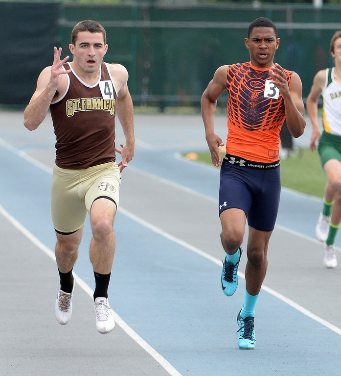. St. Francis\'s Ross Nierderhaus, left, along with Chaminade\'s Greg Campbell competes in the division 1 400 meters race during the CIF Southern Section track and final Championships at Cerritos College in Norwalk, Calif., Saturday, May 24, 2014. 