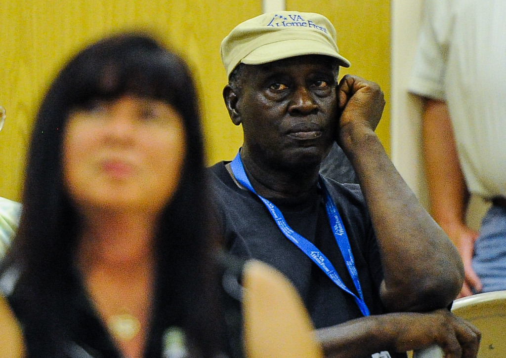""". Twenty-year Hinkley resident James Nelson, 70, listens to the latest updates about the chromium-6 groundwater plume, and PG&E\'s remediation strategies after publicly expressing his concerns for himself and his family during a Community Advisory Committee meeting in the Hinkley School auditorium in Hinkley, Calif. on Thursday, June 27, 2013. \""""All these years I washed my clothes in the water, bathed in it. I feel cheated by PG&E,\"""" Nelson said. (Rachel Luna / San Bernardino Sun)"""