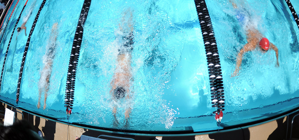 . Arroyo Grande\'s Zachary Stevens, center, touches the wall ahead of Crescenta Valley\'s Young Tae Seo, left, and Mark Keppel\'s Justin Chiu, right, to win the 100 yard Breaststroke during the CIF-SS Division II swim finals at Riverside City College on Saturday, May 11, 2013 in Riverside, Calif.  (Keith Birmingham Pasadena Star-News)