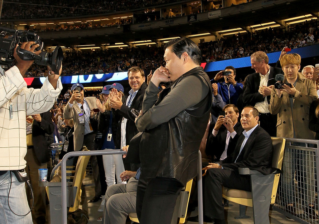 . Korean Pop musician PSY makes an appearance in the fourth inning during the MLB game between the Colorado Rockies and the Los Angeles Dodgers at Dodger Stadium on April 30, 2013 in Los Angeles, California.  (Photo by Victor Decolongon/Getty Images)