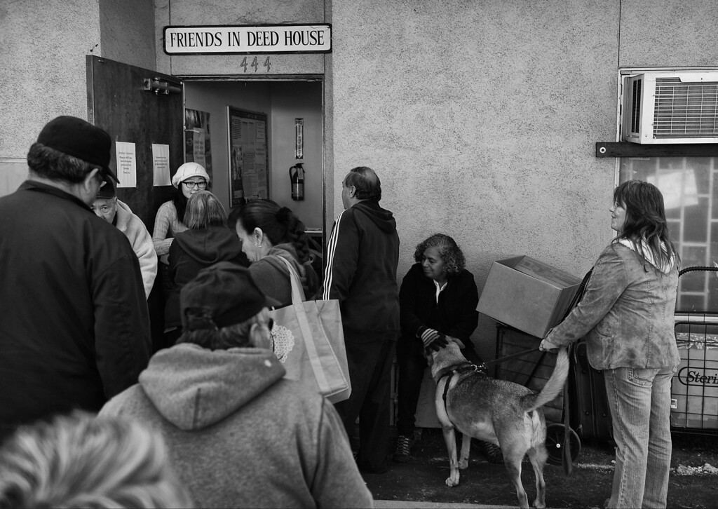 . Dorothy waits in line for food at Friends in Deed House\'s food bank where the Women\'s Room is located.