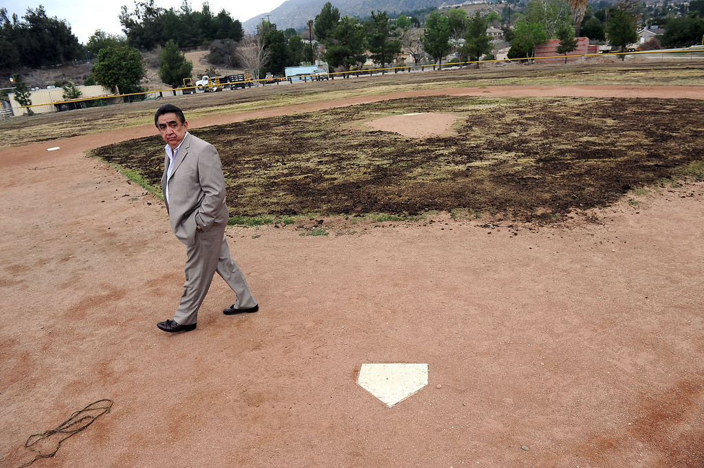 . Joe Kirk makes his way across one of the run-down baseball diamonds at the Sylmar Independent Baseball League in Sylmar, CA February 6, 2014.  Kirk is part of a group of San Fernando Valley homeowners who are suing the operators of the Sylmar Independent Baseball League, alleging that the non profit group mismanaged the league for years.(Andy Holzman/Los Angeles Daily News)