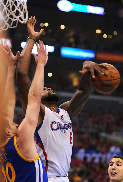 . The Clippers\' DeAndre Jordan and the Warriors\' David Lee battle for a rebound in game seven of the Western Conference playoffs, Saturday, May 3, 2014, at Staples Center. (Photo by Michael Owen Baker/L.A. Daily News)