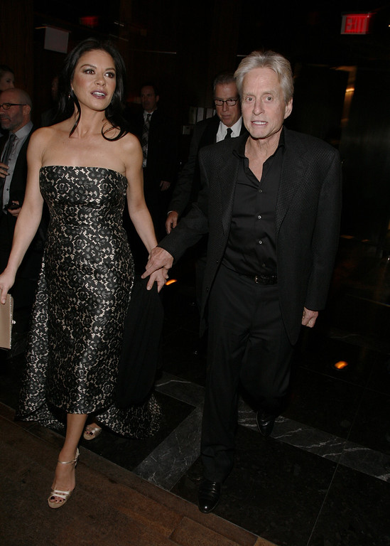 ". Actress Catherine Zeta-Jones, left, and actor Michael Douglas, right, attend the after party for the premiere of ""Side Effects\"" hosted by the Cinema Society and Open Road Films on Thursday, Jan. 31, 2013 in New York. (Photo by Andy Kropa/Invision/AP)"