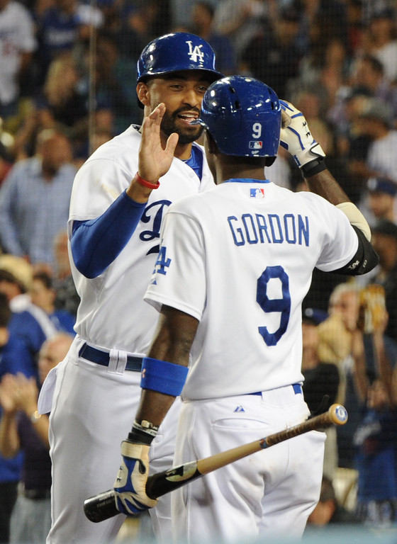 . Matt Kemp is congratulated by Dee Gordon after being driven in on a 3 RBI double hit by Miguel Rojas in the 3rd inning. The Dodgers played the Colorado Rockies at Dodger Stadium in Los Angeles, CA. 6/18/2014(Photo by John McCoy Daily News)