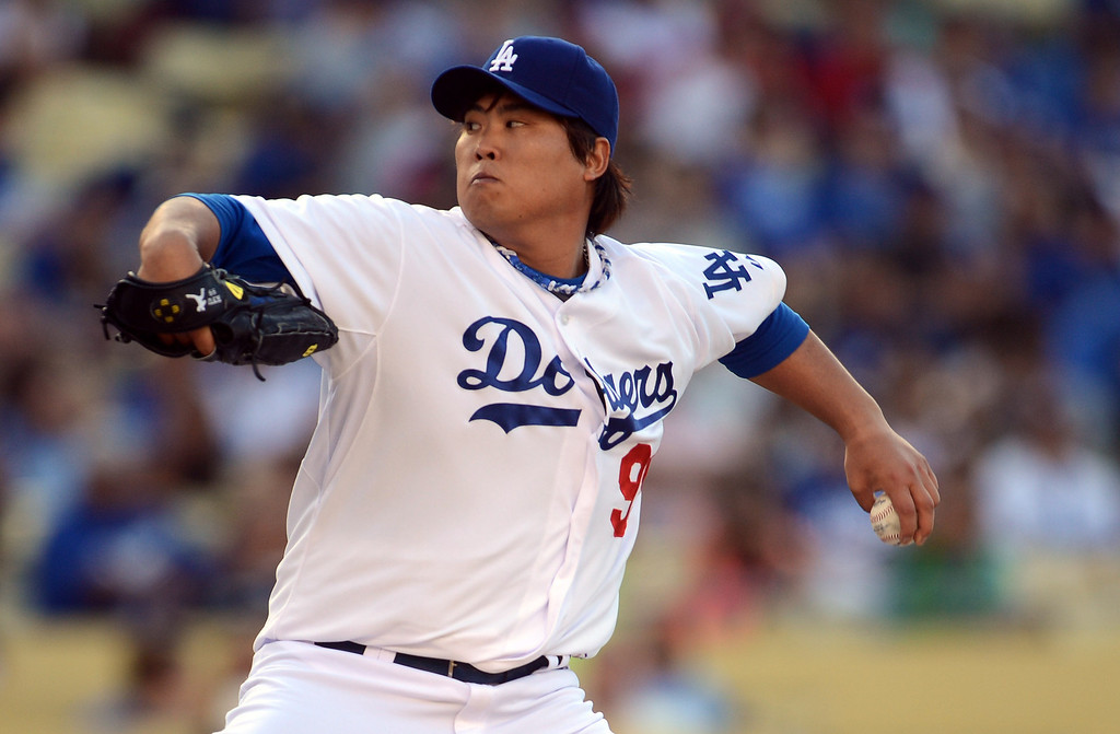 . The Dodgers\' Hyun-Jin Ryu #99 delivers a pitch during their game against Reds at Dodger Stadium in Los Angeles Saturday, July 27, 2013. (Hans Gutknecht/Los Angeles Daily News)