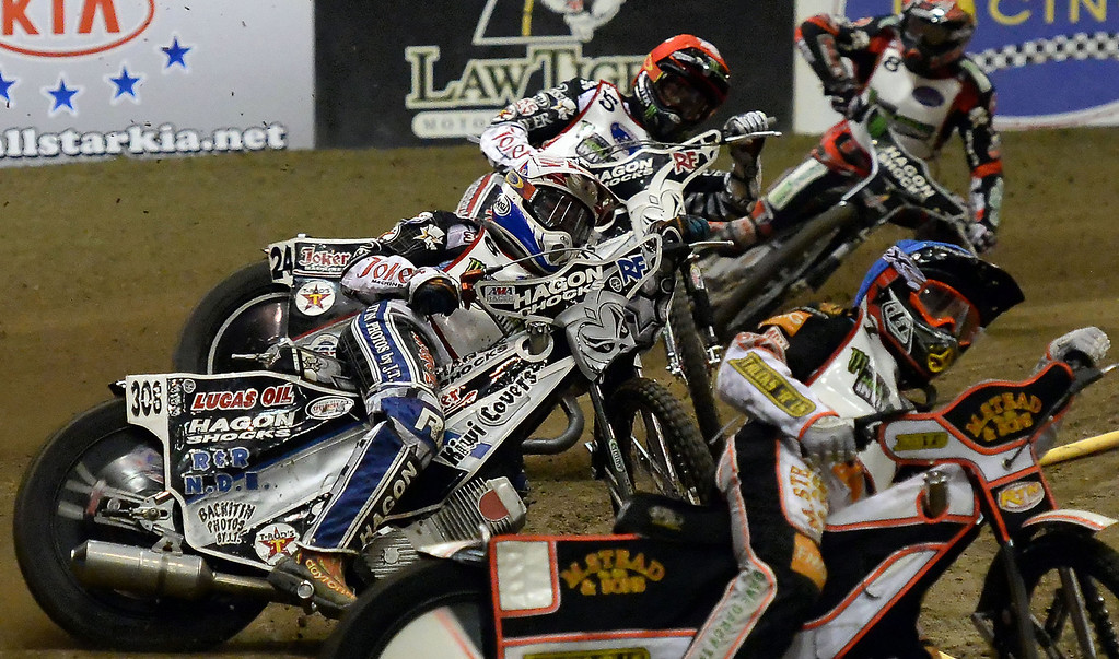 . Scott Nicholls (7), Max Ruml (6), Gino Manzares (5) and Chris Harris (8) in the second race during the Monster Energy Speedway Cycles at the Industry Speedway in the Industry Hills Grand Arena in Industry, Calif., on Saturday, Dec. 28, 2013.     (Keith Birmingham Pasadena Star-News)