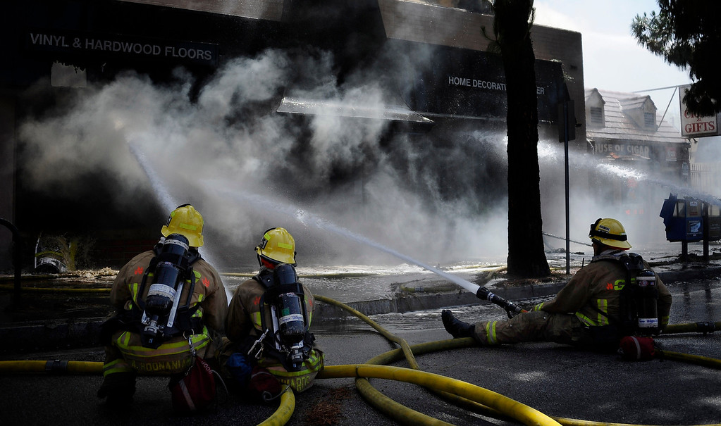 . Burbank and Glendale firefighters battle a 4 alarm fire that destroyed Beauty Kiss Carpets at the 200 blk of Glenoaks Bl. this morning Monday. It took firefighters hours to get the fire under control and the cause is under investigation. Burbank CA.  MAY 27.2013  Van Nuys CA. Photos by Gene Blevins/LA DailyNews