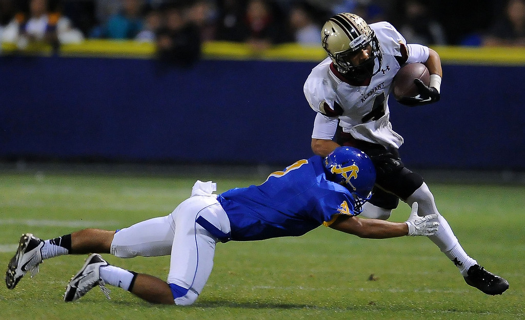 . Alemany\'s Brandon Pierce (4) in the first half of a prep football game against Bishop Amat at Bishop Amat High School in La Puente, Calif., on Friday, Oct. 25, 2013.    (Keith Birmingham Pasadena Star-News)