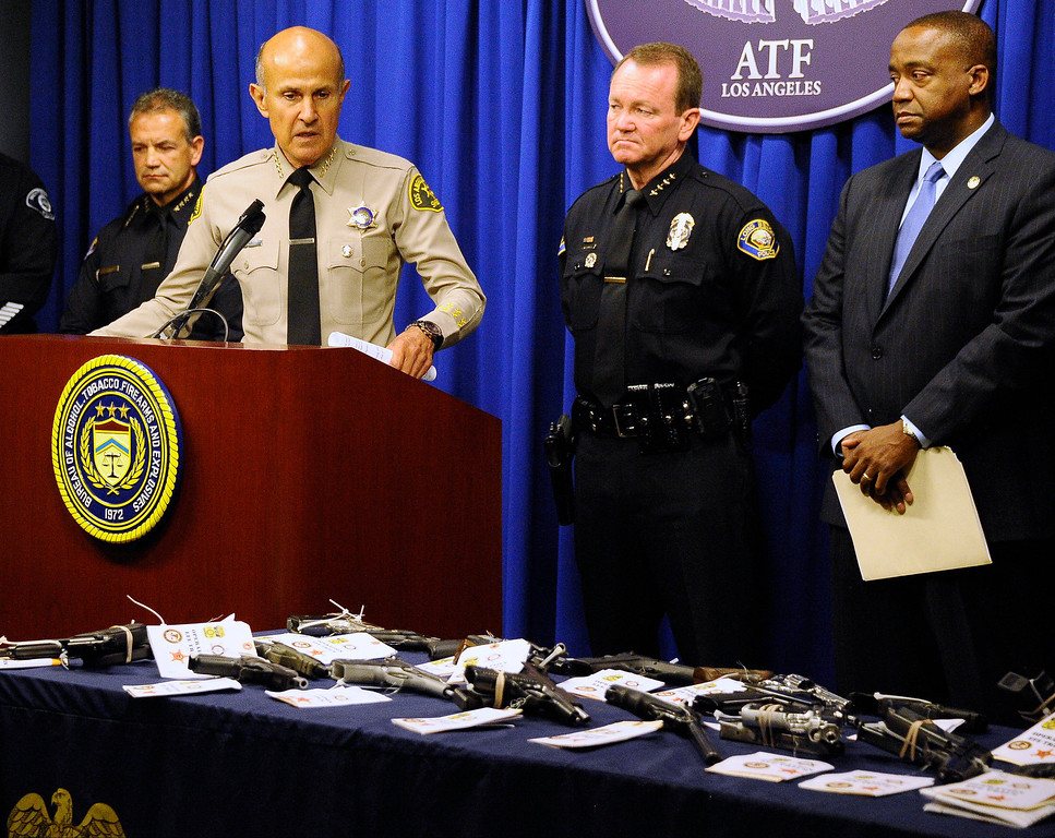 . August 6,2013 Glendale CA. LA county sheriff commander Lee Baca(L.) talks during Alcohol, Tobacco, Firearm and Explosives press conference to announce the completion of two investigations that targeted the Mexican Mafia prison gang in Glendale.  The two investigations found that the Mexican Mafia had initiated an alliance with a major Mexican drug cartel and that the prison gang continues to have strong ties to street gangs in the Los Angeles area. Agency representatives and a display of firearms recovered during this operation will be available for viewing. Photo by Gene Blevins/LA Daily News