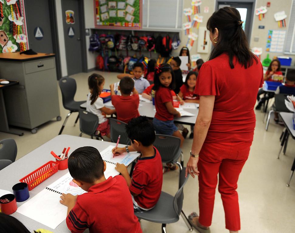 . Kindergarten teacher Maria Doyle,helps  students with her work Tuesday August 9, 2013 at Little Mountain Elementary School in San Bernardino.LaFonzo Carter/ Staff Photographer