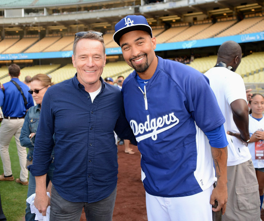 . In this handout photo provided by the Los Angeles Dodgers, Bryan Cranston and Matt Kemp attends the Cincinnatti Reds versus Los Angeles Dodgers game at Dodger Stadium on July 26, 2013 in Los Angeles, California.  (Photo by Jon Soohoo/Los Angeles Dodgers via Getty Images)