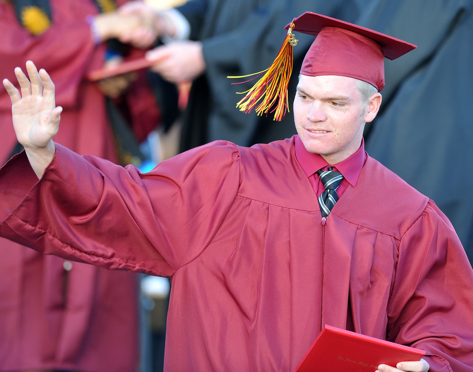 . Kyle goethe waves to family as he gets his diploma during La Serna High School\'s 51st Annual Commencement at La Mirada High School stadium in La Mirada on Thursday June 13, 2013. La Serna marked the commencement of 635 graduates and marking Principal Ann Fitzgerald\'s first graduation as principal. (SGVN/Staff Photo by Keith Durflinger)