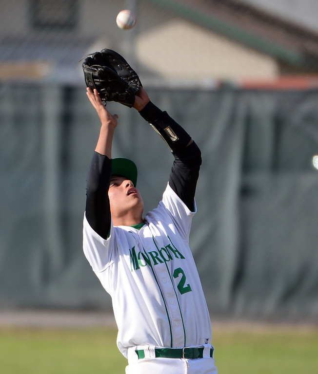 . Monrovia shortstop Nick Carino catches a pop-up by Alhambra\'s James Giambalvo (not pictured) in the sixth inning of the Arcadia Elk Baseball Tournament at Monrovia High School in Monrovia, Calif., on Thursday, March 13, 2014. Monrovia won 2-0.  (Keith Birmingham Pasadena Star-News)