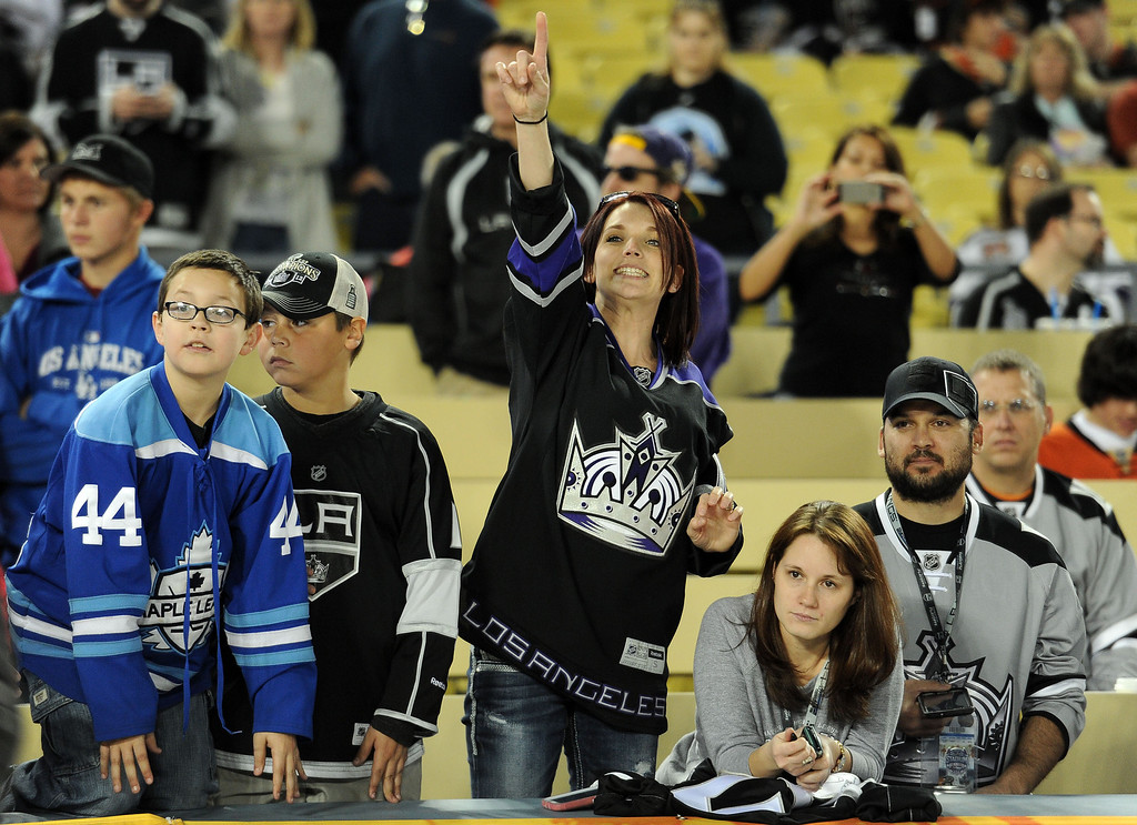 . Los Angeles Kings fans try to get the attention of actor Cuba Gooding Jr. (not pictured) prior to the start of the inaugural NHL Stadium Series game against Anaheim Ducks at Dodger Stadium in Los Angeles on Saturday, Jan. 25, 2014. (Keith Birmingham Pasadena Star-News)