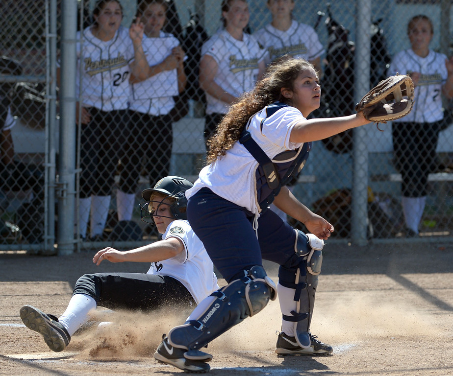 . Peninsula\'s Ashley Hughes (6) slides home ahead of a throw to Arroyo Grande in a CIF Southern Section Division III wild-card softball game in Rolling Hills Estates Tuesday. Peninsula won the game 13-0. 20130514 Photo by Steve McCrank / Staff Photographer