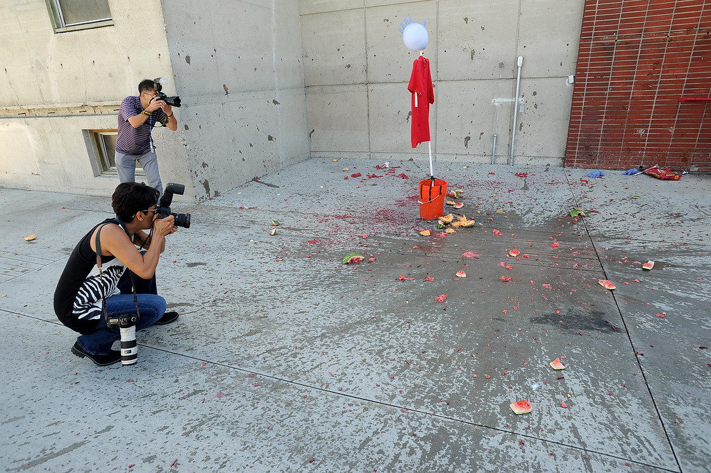 . Photographers document the scene after M-80\'s were detonated in fruit following an LAFD news conference regarding the use of fireworks as the 4th of July holiday approaches.  Fire and law enforcement officials are encouraging families to attend a professional fireworks show to reduce fires and injuries.(Andy Holzman/Los Angeles Daily News)