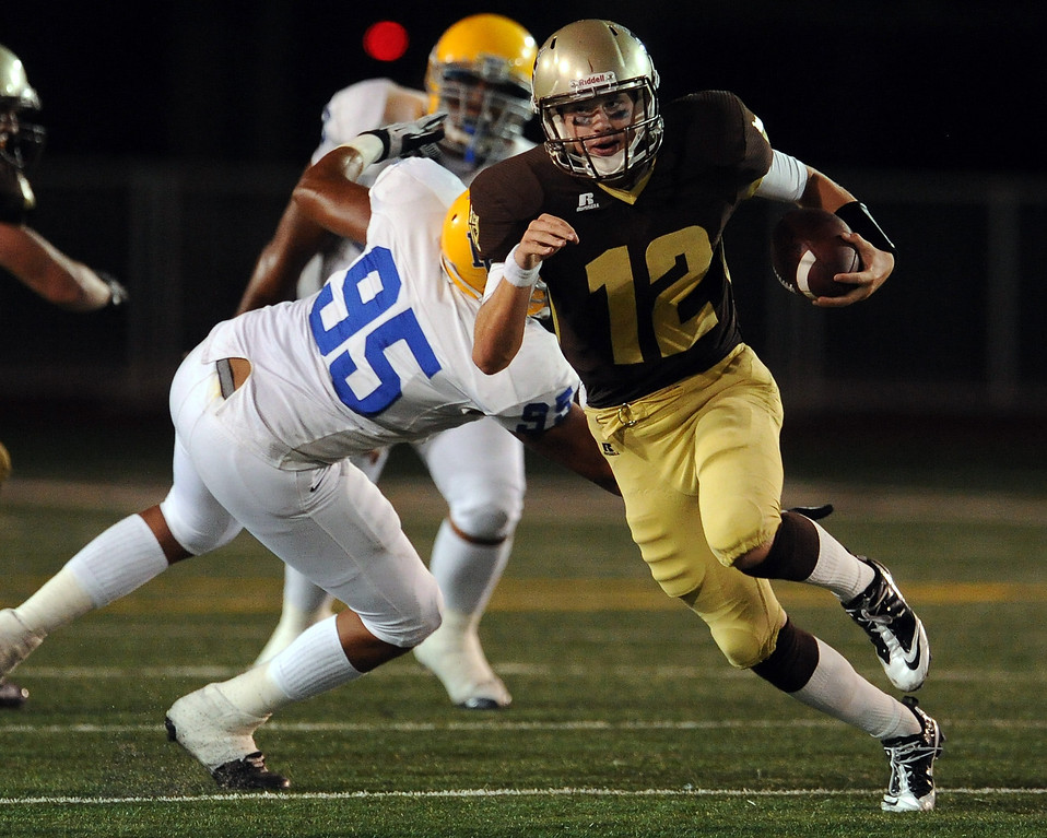 . St. Francis\' quarterback Ty Gangi (C) (12) scrambles for a first down against La Mirada in the first half of a prep football game at St. Francis High School in La Canada, Calif. on Thursday, Sept. 19, 2013.    (Photo by Keith Birmingham/Pasadena Star-News)