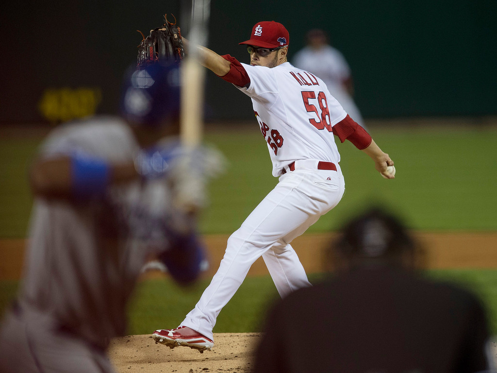 . St. Louis Cardinals starting pitcher Joe Kelly throws during the first inning of Game 1 of the National League baseball championship series against the Los Angeles Dodgers, Friday, Oct. 11, 2013, in St. Louis. (AP Photo/Al Tielemans, Pool)
