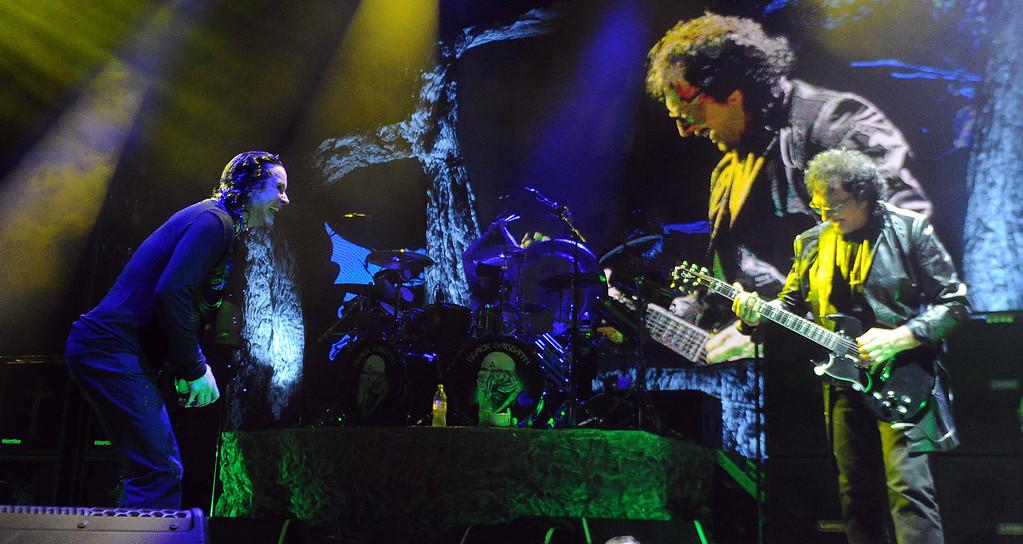 . Black Sabbath  vocalist Ozzy Osbourne, left, along with guitarist Tony Lommiv perform at the Verizon Wireless Amphitheatre on Wednesday, Aug. 28, 2013 in Irvine, Calif.   (Keith Birmingham/Pasadena Star-News)