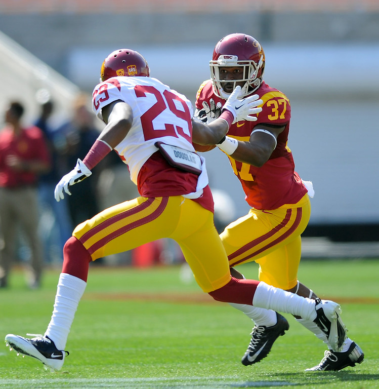 . USC DB Chris Hawkins (#29) stops a sweep by RB Javorius Allen during their spring game, Saturday, April 19, 2014, at the Coliseum. (Photo by Michael Owen Baker/L.A. Daily News)