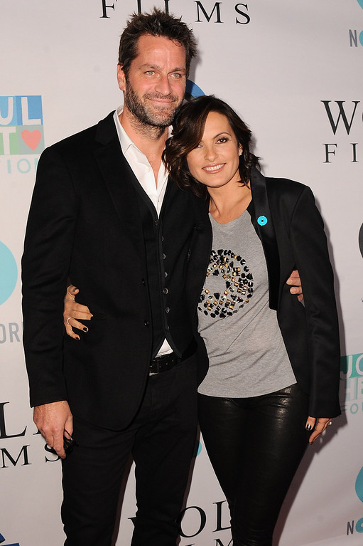 . Peter Hermann, left, and Mariska Hargitay arrive at JoyROCKS launch of the No More PSA Campaign at the MILK Studios on Thursday, Sept. 26, 2013 in Los Angeles. (Photo by Jordan Strauss/Invision/AP)