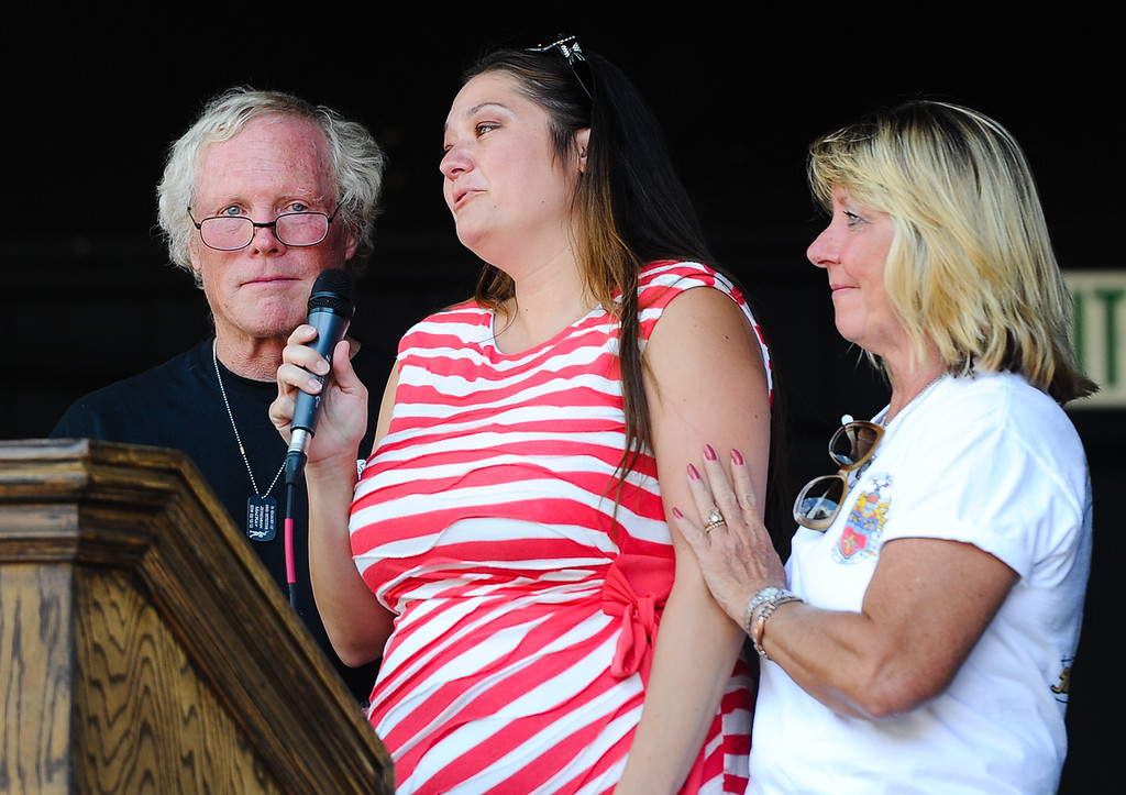 . Lynnette MacKay, wife of fallen San Bernardino County Sheriff\'s Deputy Jeremiah MacKay, is supported by in-laws Alan and Dawn MacKay as she fights back tears while thanking the public for all their support during the dedication ceremony of the Jeremiah MacKay bronze statue at the Lake Arrowhead Village in Lake Arrowhead on Sunday, Sept. 1, 2013. San Bernardino County Sheriff\'s Detective MacKay was killed on Feb. 12 in a gun battle with fugitive ex-cop Christopher Dorner near Big Bear during a massive manhunt in search of Dorner. (Rachel Luna / Staff Photographer)